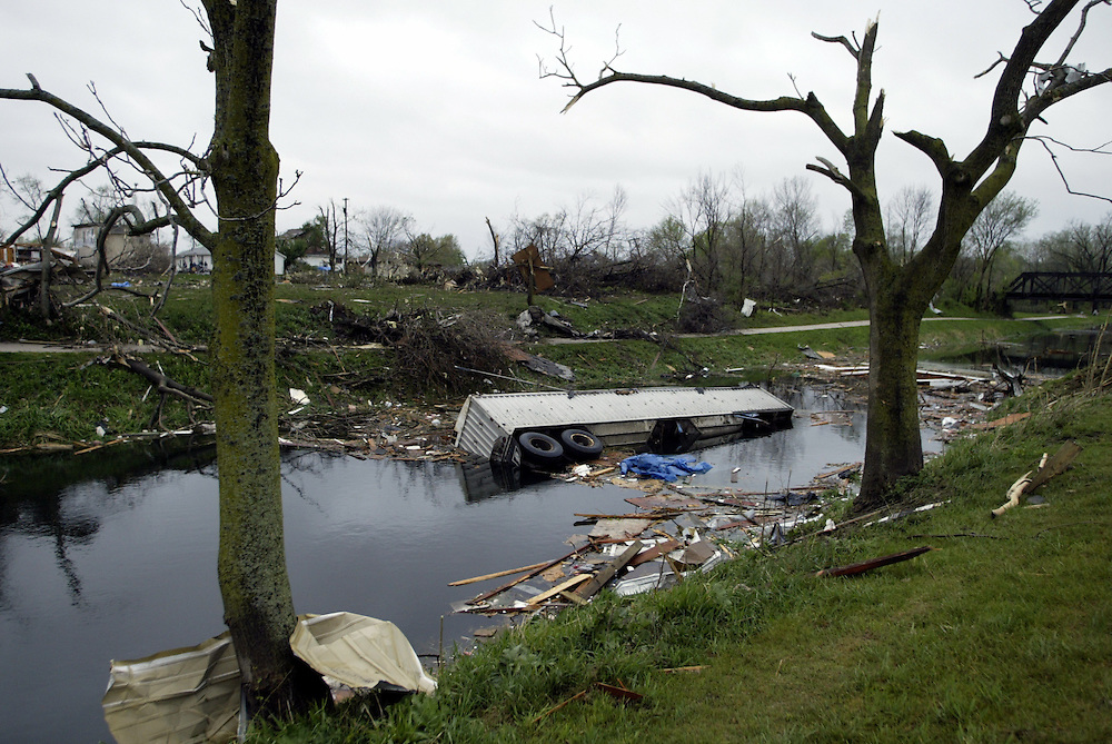A truck lies in a canal in Utica, Illinois after a large tornado touched down there Tuesday evening.  The tornado flattened many downtown buildings, including the Milestone Tavern.  At least six people were killed.  Several strong tornadoes swept across northern Illinois and Indiana Tuesday evening.  The Utica tornado was estimated to be an F3 on the Fujita scale with winds speeds estimated between 158 and 206 miles per hour. .