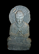 Seated Buddha from Gandhara, shows him as a teacher. Pakistan, about 2nd - 3rd century AD