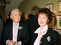 MR & MRS TERENCE FEELY, he is the playwright and she is an interior designer at an exhibition in London on 20th May 1997.LYJ 23