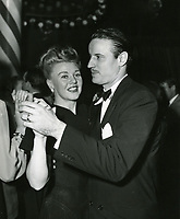 1947 Ginger Rogers and her husband, Jack Briggs dancing at The Mocambo nightclub