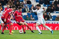 Real Madrid Fernando Alarcon 'Isco' and CD Numancia Unai Elgezabal during King's Cup match between Real Madrid and CD Numancia at Santiago Bernabeu Stadium in Madrid, Spain. January 10, 2018. (ALTERPHOTOS/Borja B.Hojas)