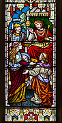 Stained glass window in church of Saint John the Baptist, Badingham, Suffolk, England, UK circa 1873 by Cox and Son, Saint John the Baptist beheaded