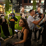 CHARLOTTE, NC - August 22:  A man and woman argue with a group  of protestors that marched into a courtyard where people were eating dinner in Charlotte's South End neighborhood during a protest organized by Charlotte Uprising  in uptown Charlotte near the site of the 2020 Republican National Convention in uptown Charlotte on August 22, 2020.  Delegates are holding private meetings inside the convention center ahead of the official start of the paired down convention on August 24th. (Photo by Logan Cyrus for AFP)
