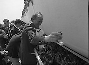 Irish Soccer Team Welcomed Home.   (R81)..1988..19.06.1988..06.19.1988..19th June 1988..After their great success in Germany in Euro 88, the Irish soccer team had a triumphant homecoming. An Taoiseach, Charles Haughey TD and his government were to the forefront of the welcome. Thousands of fans thronged the airport and all the approach roads in the hope of seeing the team. The full squad is as follows..1.GK.Packie Bonner. Celtic.2.DF.Chris Morris. Celtic.3.DF.Chris Hughton  Tottenham Hotspur.4.DF.Mick McCarthy. Celtic.5.DF.Kevin Moran. Manchester United.6.MF.Ronnie Whelan. Liverpool.7.MF.Paul McGrath. Manchester United.8.MF.Ray Houghton. Liverpool.9.FW.John Aldridge. Liverpool.10.FW.Frank Stapleton Derby County.11.MF.Tony Galvin. Sheffield Wednesday.12.FW.Tony Cascarino. Millwall.13.MF.Liam O'Brien. Manchester United.14.FW.David Kelly. Walsall.15.MF.Kevin Sheedy. Everton.16.GK.Gerry Peyton. Bournemouth.17.FW.John Byrne. Le Havre.18.FW.John Sheridan. Leeds United.19.DF.John Anderson. Newcastle United.20.FW.Niall Quinn. Arsenal..Picture shows Jack Charlton saluting the crowds at Dublin Airport.
