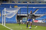 Unused substitute Rickie Lambert of Cardiff city is left to warm down in the empty stadium as seagulls circle . the ex premier league and international player can't get into the Cardiff team at the moment. EFL Skybet championship match, Cardiff city v Nottingham Forest at the Cardiff City Stadium in Cardiff, South Wales on Easter Monday 17th April 2017.<br /> pic by Andrew Orchard, Andrew Orchard sports photography.