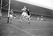 All Ireland Senior Football Championship Final, Dublin v Galway, 22.09.1963, 22nd September 1963, Dublin 1-9 Galway 0-10,.Dublin Full Back L Foley catches a high ball near own goalmouth and returns to earth with Galway Full Forward S Cleary on right ..