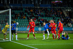 TALLINN, ESTONIA - Monday, October 11, 2021: Estonia's Sergei Zenjov clears the ball off the line, but only into the path of Wales' Kieffer Moore who scores the only goal of the game, during the FIFA World Cup Qatar 2022 Qualifying Group E match between Estonia and Wales at the A. Le Coq Arena. Wales won 1-0. (Pic by David Rawcliffe/Propaganda)