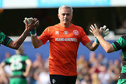 2 September 2017 - Charity Football - Game 4 Grenfell - Goalkeeper Jose Mourinho hi-fives his team mates - Photo: Charlotte Wilson