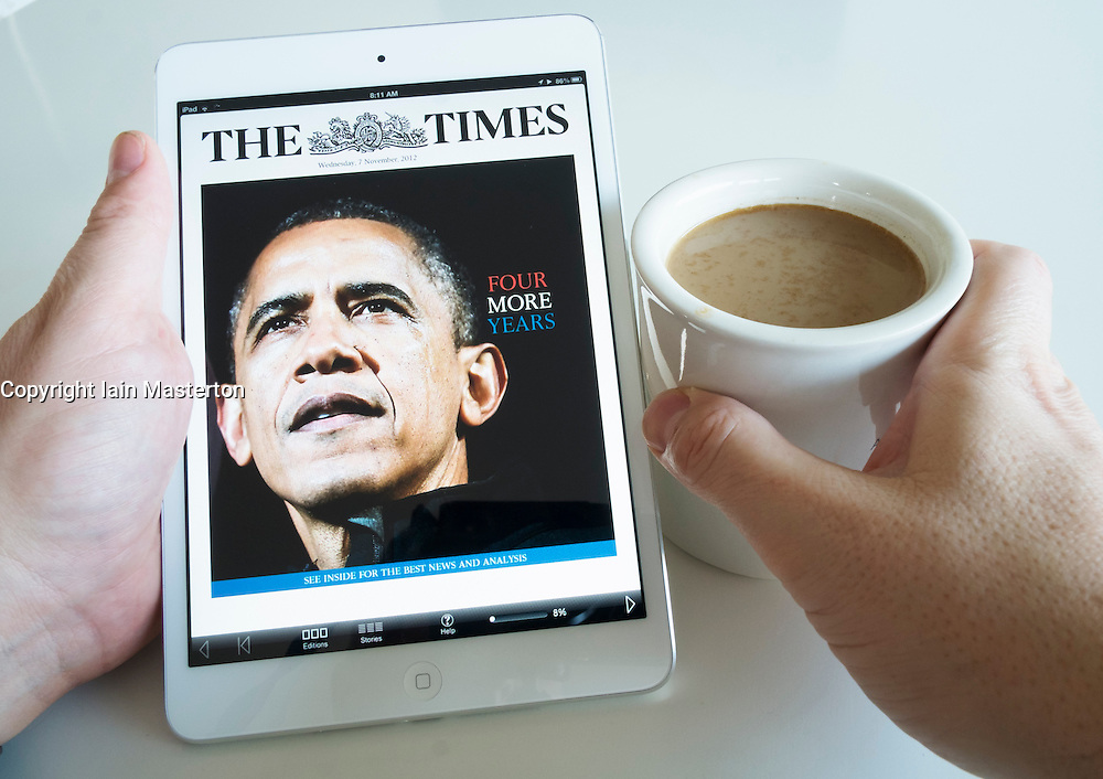 Reading the digital edition of The Times newspaper on an iPad mini tablet computer