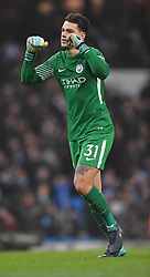 Manchaster City's Ederson celebrates at the final whistle