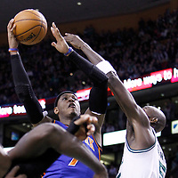 04 March 2012: New York Knicks small forward Carmelo Anthony (7) goes for the layup over Boston Celtics power forward Kevin Garnett (5) during the Boston Celtics 115-111 (OT) victory over the New York Knicks at the TD Garden, Boston, Massachusetts, USA.