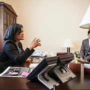 Representative Pramila Jayapal (D-WA, 7) eats lunch at her desk, while meeting with her Deputy chief of Staff, Ven Neralla, right, and Legislative Assistant, Jennifer Chan, not pictured, on Tuesday, January 31, 2017.  John Boal photo/for The Stranger