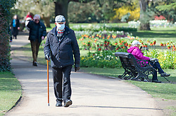 © Licensed to London News Pictures 13/04/2021. Greenwich, UK. A man out walking wearing a mask. People enjoying the sunny weather and exercising in Greenwich Park, London as coronavirus lockdown restrictions continue to ease in the UK. Photo credit:Grant Falvey/LNP