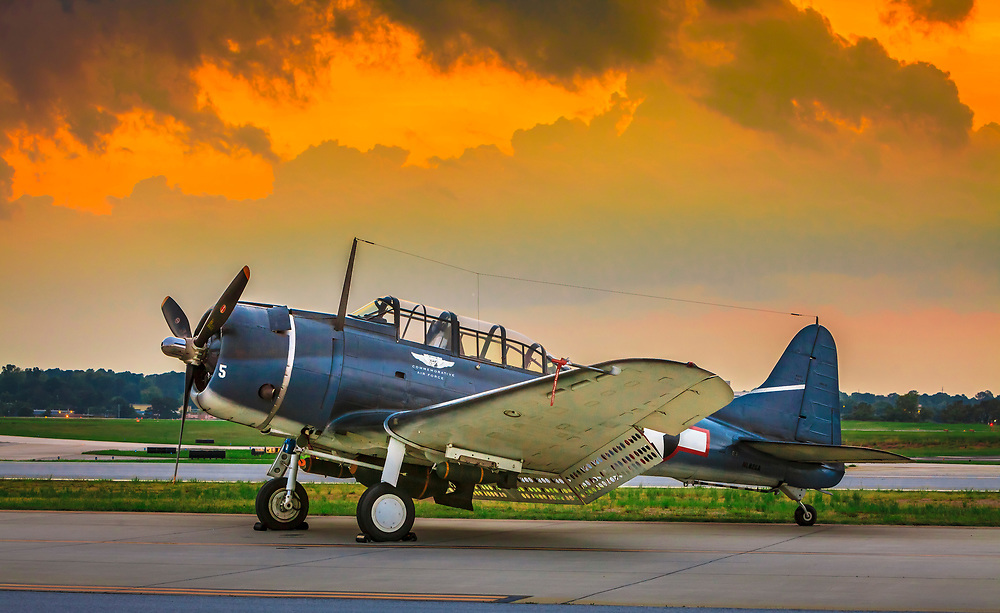 """SBD-5 """"Dauntless"""" Dive Bomber, operated by the Dixie Wing of the Commemorative Air Force.  Dekalb Peachtree Airport (PDK), Atlanta.  <br /> <br /> Created by aviation photographer John Slemp of Aerographs Aviation Photography. Clients include Goodyear Aviation Tires, Phillips 66 Aviation Fuels, Smithsonian Air & Space magazine, and The Lindbergh Foundation.  Specialising in high end commercial aviation photography and the supply of aviation stock photography for advertising, corporate, and editorial use."""
