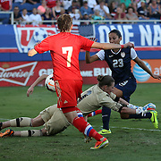 U.S. forward Christen Press (23) scores a goal against Russia goalkeeper Elvira Todua (1) during an international friendly soccer match between the United States Women's National soccer team and the Russia National soccer team at FAU Stadium on Saturday, February 8, in Boca Raton, Florida. (AP Photo/Alex Menendez)