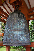 """Visitors entering Byodo-In Temple on Oahu are invited to ring the 6-foot-high sacred bell (bon-sho), which was cast in Osaka, Japan and weighs over 7 tons. Ringing the bell is intended to relieve negativity, impart peace, bring happiness, and remind us that everything is transitory. Peaceful Byodo-In Temple is in Valley of the Temples Memorial Park, at 47-200 Kahekili Highway, in Kaneohe, on the island of Oahu, Hawaii, USA. With its name translated as """"Temple of Equality,"""" Byodo-In was built in 1968 to commemorate the 100 year anniversary of the first Japanese immigrants to Hawaii. This Hawaii State Landmark is a non-practicing Buddhist temple which welcomes people of all faiths. Byodo-In Temple in O'ahu is a half-scale replica of the original Byodo-in Temple built in 1053 AD in Uji, Japan (a UNESCO World Heritage Site)."""