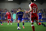 AFC Wimbledon midfielder Alex Woodyard (4) dribbling and battles for possession during the EFL Sky Bet League 1 match between AFC Wimbledon and Gillingham at Plough Lane, London, United Kingdom on 23 February 2021.