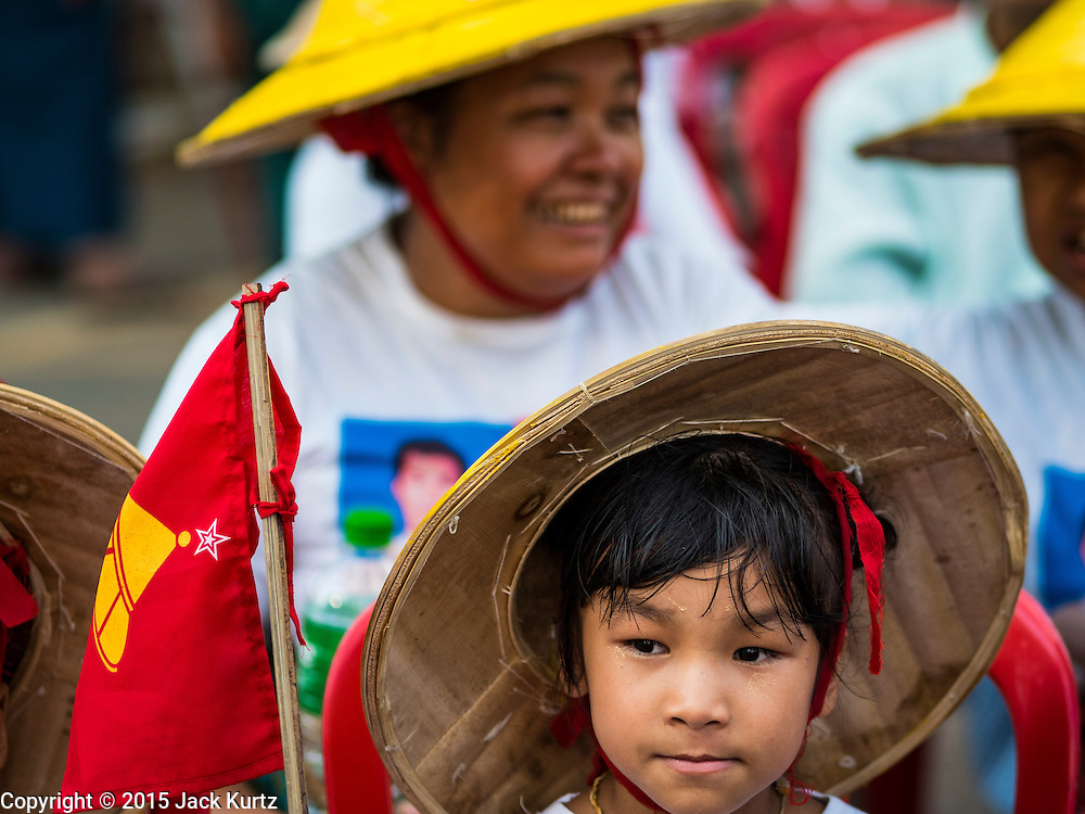 06 NOVEMBER 2015 - YANGON, MYANMAR:  People wait for the final NDF election rally of the 2015 election to start. The rally was held in central Yangon, next to the historic Sule Pagoda and across the street from Yangon city hall. The National Democratic Force (NDF) was formed by former members of the National League for Democracy (NLD) who chose to contest the 2010 general election in Myanmar because the NLD boycotted that election. There have been mass defections from the NFD this year because many of the people who joined the NFD in 2010 have gone back to the NLD, which is contesting this year's election and widely expected to win it. Campaigning in the Myanmar election ended Friday. People go to the polls Sunday.    PHOTO BY JACK KURTZ