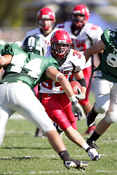 04 October 2008: Jake Smith takes the ball towards the Red Men goal in a battle between the Carthage Red Men and the Illinois Wesleyan University Titans, Game action was at Wilder Field on the campus of Illinois Wesleyan University in Bloomington Illinois.