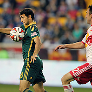 Diego Valeri, (left), Portland Timbers, is challenged by Eric Alexander, New York Red Bulls, during the New York Red Bulls Vs Portland Timbers, Major League Soccer regular season match at Red Bull Arena, Harrison, New Jersey. USA. 24th May 2014. Photo Tim Clayton