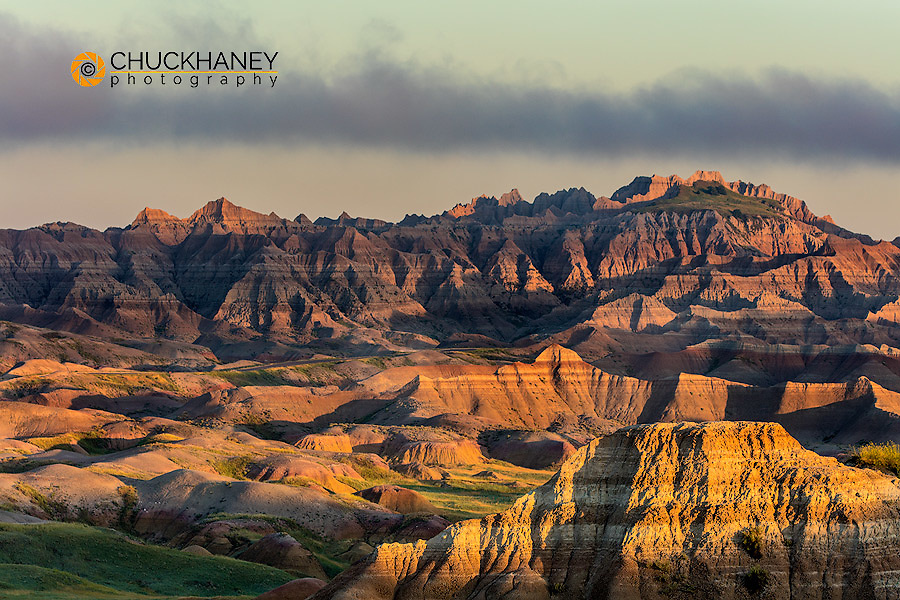 Sunrise light breaks through ona foggy morning in Badlands National Park, South Dakota, USA