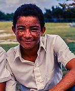 Head and shoulders portrait teenage boy with freckles, Cayman Brac High School, Cayman Islands, West Indies, c 1990