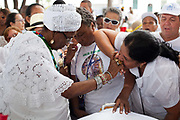 People showing their devotion to the Bahianas who represent the tradition of Candomble Umbanda, Every second 2nd Thursday in February thousands of people attend the Lavagem do Bonfim - The washing of Bonfim at the Iglesia do Bonfim - Church of Bonfim in Salvador de Bahia,