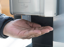 A man dispenses hand sanitizer in a shopping mall in the Montreal borough of Pointe-Claire, Saturday, March 14, 2020, as COVID-19 cases rise in Canada and around the world. THE CANADIAN PRESS/Graham Hughes