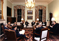 Washington, D.C. - February 21, 1991 -- United States President George H.W. Bush, far right, meets with National Security Advisor General Brent Scowcroft, right foreground, White House Chief of Staff Governor John Sununu, left foreground, Central Intelligence Agency (CIA) Director Robert Gates, Chairman of the Joint Chiefs of Staff, General Colin Powell, Secretary of State James A. Baker, White House Press Secretary Marlin Fitzwater, Vice President Dan Quayle, Richard Haas and Secretary of Defense Dick Cheney in the residence office to discuss the United States response to the Soviet peace plan with Iraq in Washington, DC on February 21, 1991. Photo by White House/CNP/ABACAPRESS.COM