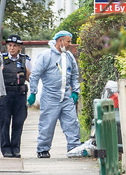 © Licensed to London News Pictures. 18/08/2018. Catford, UK. An investigator in a protective suit enters a property where a man in his 50's has been stabbed to death in Catford, south London. Police were called at 4am, the victim was pronounced dead at the scene at 5.28am. No arrests have been made. Photo credit: Peter Macdiarmid/LNP