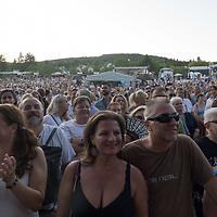 Revellers enjoy the Paloznak Jazz Picnic music festival held in Paloznak, Hungary on July 29, 2021. ATTILA VOLGYI
