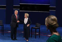 Donald Trump and and Hillary Clinton shake hands on stage after the second debate between the Republican and Democratic presidential candidates on Sunday, October 9, 2016 at Washington University in St. Louis, Mo. Photo by Christian Gooden/St. Louis Post-Dispatch/TNS/ABACAPRESS.COM