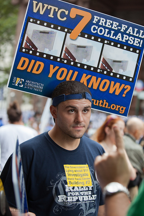 Jason Giantonio holds up a 'Remember building 7' sign at a rally to find out the truth about September 11th held on 10th anniversary of the 9/11 attacks on the World Trade Center towers across from St Paul's Chapel near ground zero. The 9/11 Truth Movement started in 2006 by family members who want answers about what happened on 9/11and have staged rallies at Ground Zero every year on 9/11.