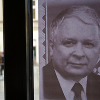 Photos of late Polish president Lech Kaczynski and his wife Maria Kaczynska are displayed on a cafe window  during their funeral in Krakow, Poland. Sunday, 18. April 2010. ATTILA VOLGYI The presidental coupple died in the tragic airplane accident at Smolensk in Russia.