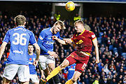 Andy Rose of Motherwell & Joe Worrall of Rangers challenge for a header during the Ladbrokes Scottish Premiership match between Rangers and Motherwell at Ibrox, Glasgow, Scotland on Sunday 11th November 2018.