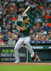 April 29, 2018 - Houston, TX, U.S. - HOUSTON, TX - APRIL 29:  Oakland Athletics designated hitter Khris Davis (2) watches the pitch during the baseball game between the Oakland Athletics and Houston Astros on April 29, 2018 at Minute Maid Park in Houston, Texas.  (Photo by Leslie Plaza Johnson/Icon Sportswire) (Credit Image: © Leslie Plaza Johnson/Icon SMI via ZUMA Press)