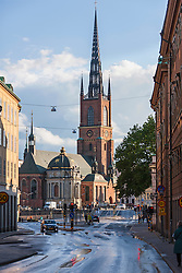 Cars on road with church in the background, Riddarholm Church, Stockholm, Sweden