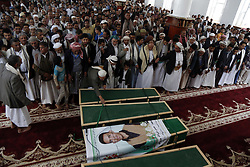 May 24, 2019, Sanaa, Yemen: People pray beside coffins during a burial ceremony held for victims of recent airstrikes launched by the Saudi-led coalition, in Sanaa, Yemen. (Credit Image: © Nieyunpeng/Xinhua via ZUMA Wire)