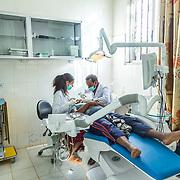 INDIVIDUAL(S) PHOTOGRAPHED: Dr. Mehiret Abera (left) and Dr. Zerihun Niguse (right). LOCATION: Felege Hiwot Referral Hospital, Bahir Dar, Ethiopia. CAPTION: Dr. Mehiret Abera and Dr. Zerihun Niguse perform dental surgery.