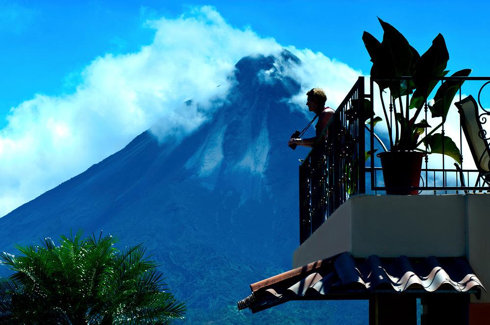 Costa Rica, El Castillo, Mountain Lodge, Arenal Volcano, Lava Flows, Tourist Resort, Tourist With Binoculars Enjoying The Views, Model & Property Released