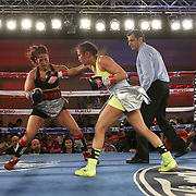Nydia Feliciano (R) punches Noemi Bosques  with a right hand during a Telemundo Boxeo boxing match at the A La Carte Pavilion on Friday,  March 13, 2015 in Tampa, Florida.  Feliciano won the bout by split decision. (AP Photo/Alex Menendez)