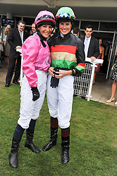 Left to right, EMMA SPENCER and FRANCESCA CUMANI at the 3rd day of the 2011 Glorious Goodwood Racing Festival - Ladies Day at Goodwood Racecourse, West Sussex on 28th July 2011.