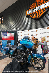 Taking photos after the unveiling at J and L Harley-Davidson of the 2018 Harley-Davidson Street Glide donated by the Motor Company and customized by J and L to commemorate the christening of the USS South Dakota submarine. Sioux Falls, SD. USA. Monday October 9, 2017. Photography ©2017 Michael Lichter.