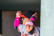 Manny Machado #13 of the Baltimore Orioles adjusts his hat in the dugout before a game against the Minnesota Twins on May 12, 2013 at Target Field in Minneapolis, Minnesota.  The Orioles defeated the Twins 6 to 0.  Photo: Ben Krause