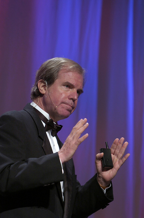 Austin, Texas May 4, 2006: Nicholas Negroponte, co-founder of the Massachusetts Institute of Technology (MIT) Media Lab and current head of the non-profit One Laptop per Child, speaks to delegates at the bi-annual World Congress of Information Technology (WCIT) final banquet.  ©Bob Daemmrich