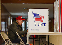Dave Spooner sits at the voting booth at Leavitt Park Clubhouse to cast his vote in the NH Primary on Tuesday morning.  (Karen Bobotas/for the Laconia Daily Sun)