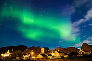 The northern lights over the town of Sorland on Vaeroy Island, Lofoten Islands, Norway.