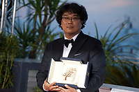 Director Bong Joon-Ho winner of the Palme d'Or award for the film Parasite at the Palme D'Or Award photo call at the 72nd Cannes Film Festival, Saturday 25th May 2019, Cannes, France. Photo credit: Doreen Kennedy