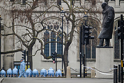 © Licensed to London News Pictures. 23/03/2017. London, UK. Police forensics perform fingertip searches in Parliament Square, the day after a lone terrorist killed 4 people and injured several more, in an attack using a car and a knife. The attacker managed to gain entry to the grounds of the Houses of Parliament, killing one police officer. Photo credit: Ben Cawthra/LNP