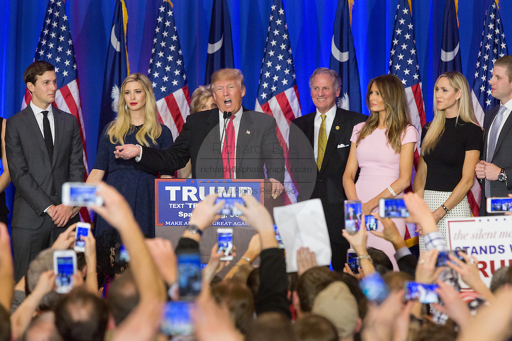 Billionaire and GOP presidential candidate Donald Trump acknowledges cheering supporters along with his family and Lt. Gov. Henry McMasters as they celebrate victory in the South Carolina Republican primary February 20, 2016 in Spartanburg, South Carolina, USA .